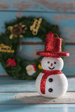 Christmas snowman and gifts decorated on grunge blue wooden back Stock Images