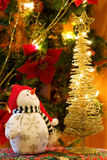 Christmas Snowman and golden tree Stock Photo