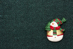 Christmas snowman on green fabric background Stock Images