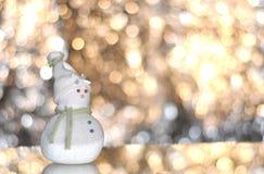 Christmas snowman. Handmade christmas snowman with bokeh backgound Stock Image