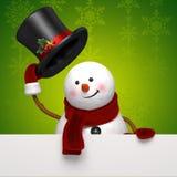 Christmas snowman hat greeting. Christmas Snowman holding festive greeting banner Stock Photos