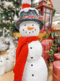 Christmas snowman in a hat and  scarf Stock Image
