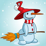Christmas snowman with hat and striped scarf holding broomstick Royalty Free Stock Photo