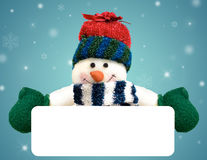 Christmas snowman holding blank banner Royalty Free Stock Images