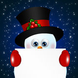 Christmas snowman holding blank over blue background Royalty Free Stock Images