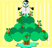 Christmas Snowman on Holly Tree Royalty Free Stock Photo