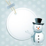 Christmas snowman and label. Christmas background with snowman indicating white label with space for message on a blue snowflacke background Stock Photo