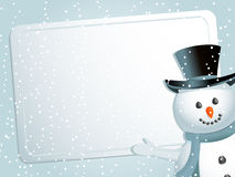 Christmas snowman, label and snow. Christmas background with snowman indicating white label with space for message on a blue snowflacke background Royalty Free Stock Images