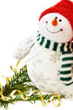 Christmas Snowman and pine tree. Celebrating Christmas with cute Snow Man and traditional pine tree branch. Isolated on white background. This image is exclusive stock photography
