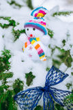 Christmas Snowman on pine tree Royalty Free Stock Image