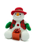 Christmas snowman with present. Cuddly snowman holding a present Stock Image