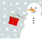Christmas snowman with present Royalty Free Stock Photography