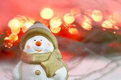 Christmas Snowman and red lights Royalty Free Stock Image