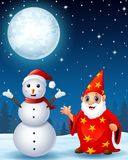 Christmas snowman with red old wizard in the winter night background Royalty Free Stock Image