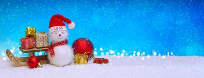 Happy New 2018 Year background with Snowman and Christmas gifts. Stock Photography