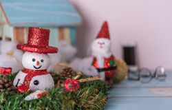 Christmas snowman,Santa  and gifts decorated on grunge blue wood Royalty Free Stock Image