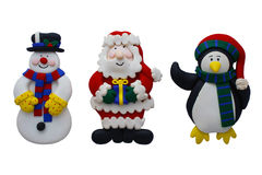 Christmas Snowman Santa and Penguin. Characters on an isolated white background with a clipping path Stock Photos