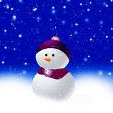 Christmas snowman. Snowman with scarf hat blue snow background Stock Photo