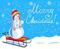 Christmas. Snowman on a sled. hand drawn lettering Stock Photo