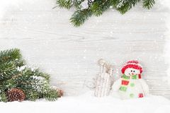 Christmas snowman and sledge toys and fir tree branch. Xmas backdrop with copy space Royalty Free Stock Photography
