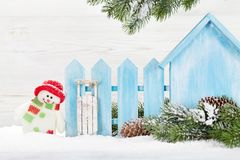 Christmas snowman and sledge toys and fir tree branch. Christmas snowman and sledge toys, gift box and fir tree branch Stock Photo