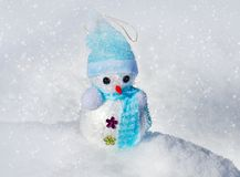 Christmas Snowman in snow stock image