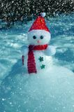 Christmas Snowman in snow royalty free stock images