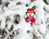 Christmas Snowman  - Stock Photos. Christmas Snowman on pine tree : funny toy ornament  on snow and needles  Background  - Outdoors Stock Images