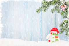 Christmas snowman toy and fir tree Royalty Free Stock Image