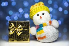 Christmas snowman toy with gift box or present Royalty Free Stock Photo