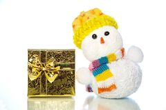 Christmas snowman toy with gift box or present Royalty Free Stock Images