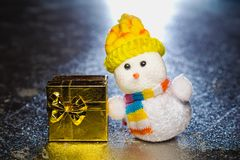 Christmas snowman toy with gift box or present Stock Images