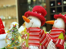 Christmas snowman toys. Close up of two Christmas snowman teddy bears with decorative ornament in foreground, festive scene stock images