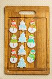 Christmas snowman and tree cookies on the cutting board winter selebration background. Christmas snowman and tree cookies on the cutting board winter Stock Photo