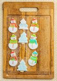 Christmas snowman and tree cookies on the cutting board winter selebration background. Christmas snowman and tree cookies on the cutting board winter Royalty Free Stock Photography