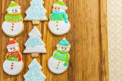 Christmas snowman and tree cookies on the cutting board winter selebration background. Christmas snowman and tree cookies on the cutting board winter Royalty Free Stock Image