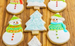 Christmas snowman and tree cookies on the cutting board winter selebration background. Christmas snowman and tree cookies on the cutting board winter Stock Images