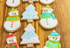 Christmas snowman and tree cookies on the cutting board winter selebration background. Christmas snowman and tree cookies on the cutting board winter Royalty Free Stock Photos