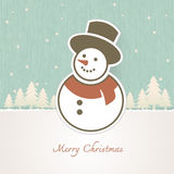 Christmas Snowman with trees covered in snow Stock Images