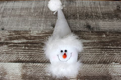 Christmas snowman in white hat. Soft toy smiling Stock Photography