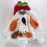 Christmas snowman from white scarf, red hat and leaf Stock Images