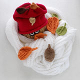 Christmas snowman from white scarf, red hat and leaf Stock Photography