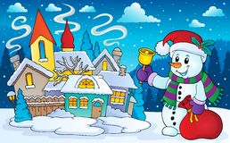 Christmas snowman in winter scenery Royalty Free Stock Image