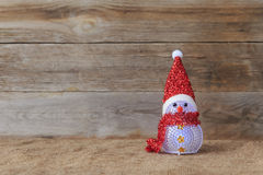 Christmas, snowman. On wood background Royalty Free Stock Photography