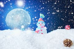 Christmas snowman with Xmas lights and snow on moonlights. The elements of this image furnished by NASA royalty free stock images