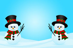 Christmas snowmans in snow with place for text Royalty Free Stock Photos