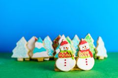 Christmas snowmans and trees ont eh background cookies winter composition. Stock Images
