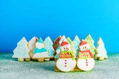 Christmas snowmans and trees ont eh background cookies winter composition. Royalty Free Stock Image