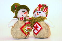 Christmas snowmen. Doll christmas snowmen isolated on white Stock Images