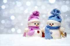 Christmas snowmen couple with gifts. On Christmas background Stock Photography